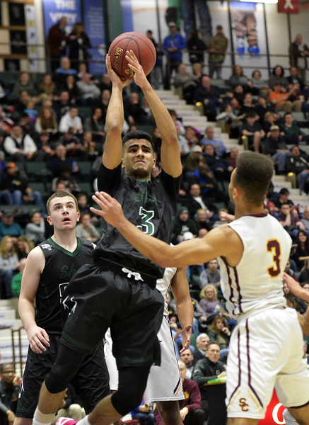 STAN HUDY - SHUDY@DIGITALFIRSTMEDIA.COM<br /> Shenendehowa's Abbas Merchant goes up for a shot during  Saturday's Section II Class AA final versus Colonie at the Cool Insuring Arena in Glens Falls. March 3, 2018.