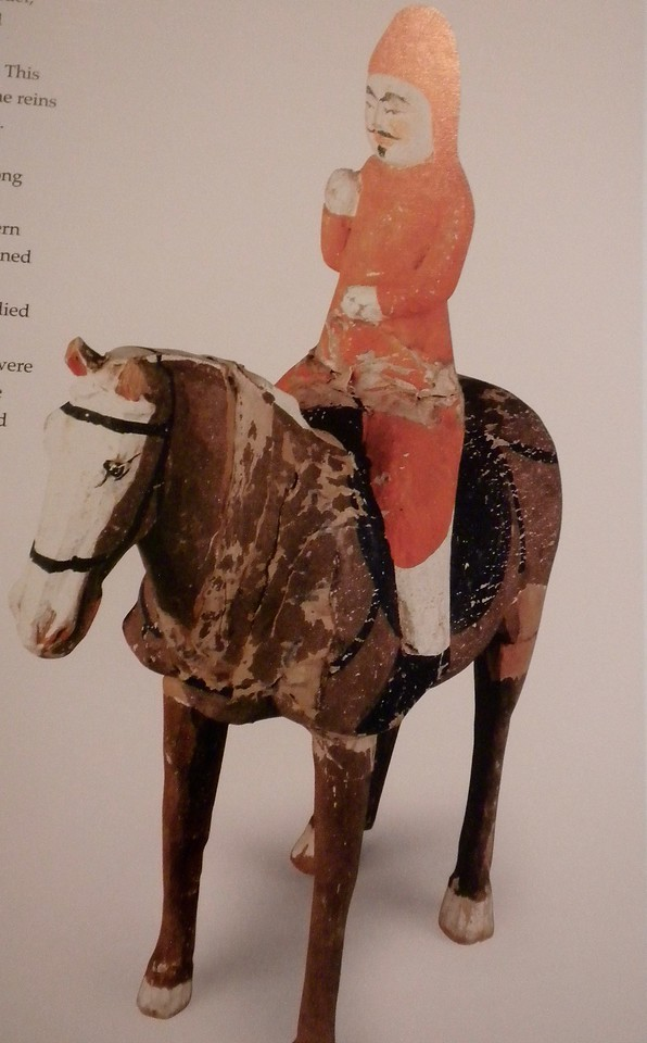 Painted figurine of mounted military officer page 93