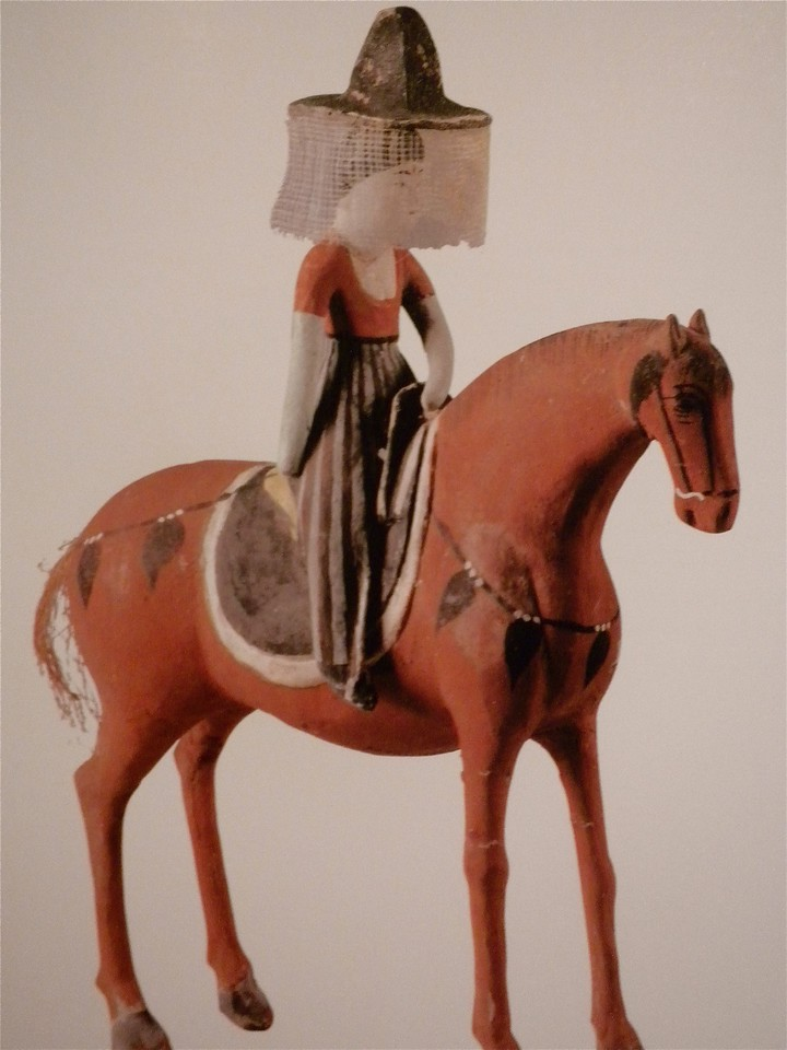 Painted clay figure of an equestrienne page 97