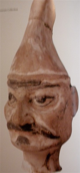 Head of a figurine wearing a pointed cap page 106
