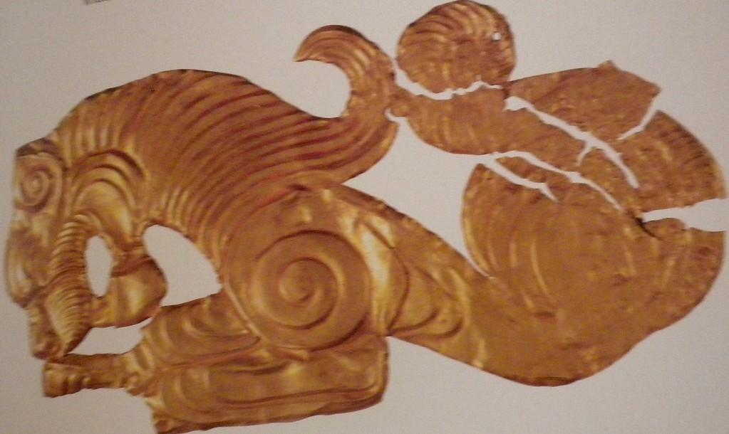 Golden plaque with lion design page 133