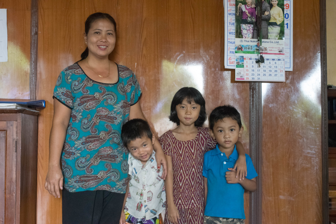Pastor's wife and kids at Trinity Nazarene.  She was one of the happiest people we met on the trip.