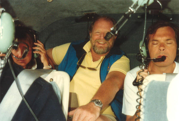 Several of us stopped in Auckland on the way home from Freo, at the invitation of (not yet Sir) Mike Faye. Barbara Lloyd & de enjoying the chopper ride to Great Mercury Island. Peter Debreceny is afraid to look. - photo by the pilot
