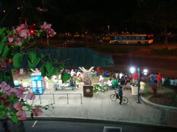 from 2nd deck of Ala Moana Mall looking down the bus stop crowd. people were waiting to see fireworks.