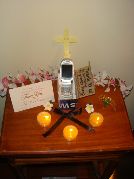 8/01 Friday, after volunteering at USO, came to back to Ben's place and he created a shrine for my cell phone.. just to make me laugh!