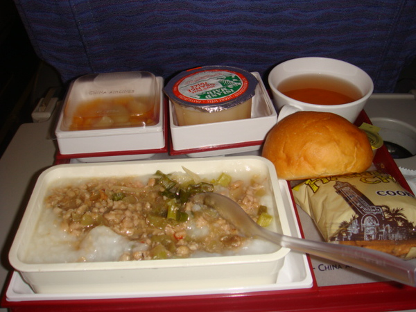 first meal on the flight. water rice and goodies..