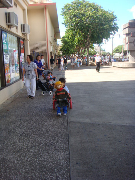 11/02, Out by Chinese Cultural Plaza by River, this boy is riding a walking monkey.. so cute..