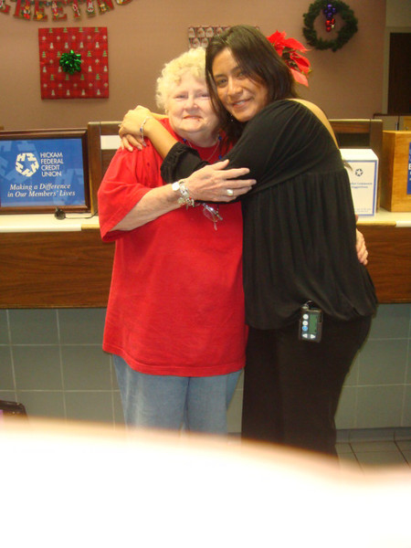 120508 Sandy in red was working for Hickam Thrift Shop is leaving for her home Pleasant Hope, MO. Erika gave her a farewell hug...