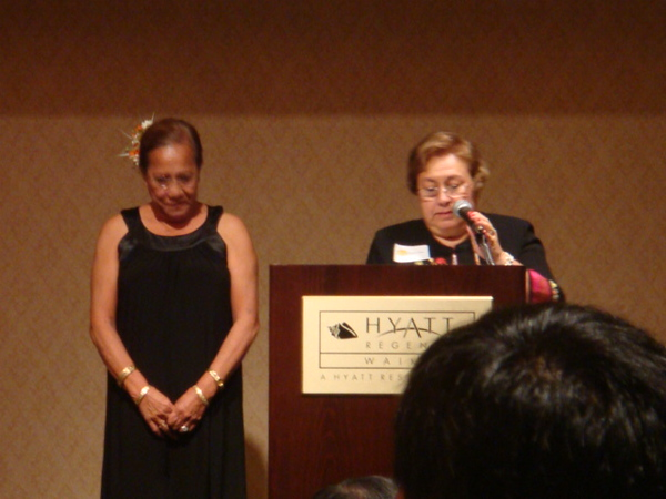 12062008  Hickam FCU Xmas party at Hyatt Regency grand ballroom,  saying a grace before chow time.. Naomi and Carol at the podium