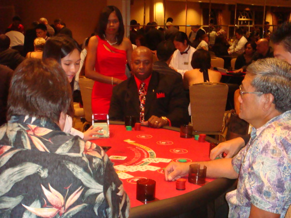 all these serious players.. Casino night was a big hit for all the employees.   Jo Ann watching her hubby Gary playing.