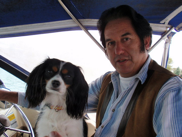 A close shot of GT, on his boat with their cute pet .. GT looks very content, peaceful... He has everything he wanted, young beautiful Dutch wife, big house, fancy motorcycle, and of course a boat, and....