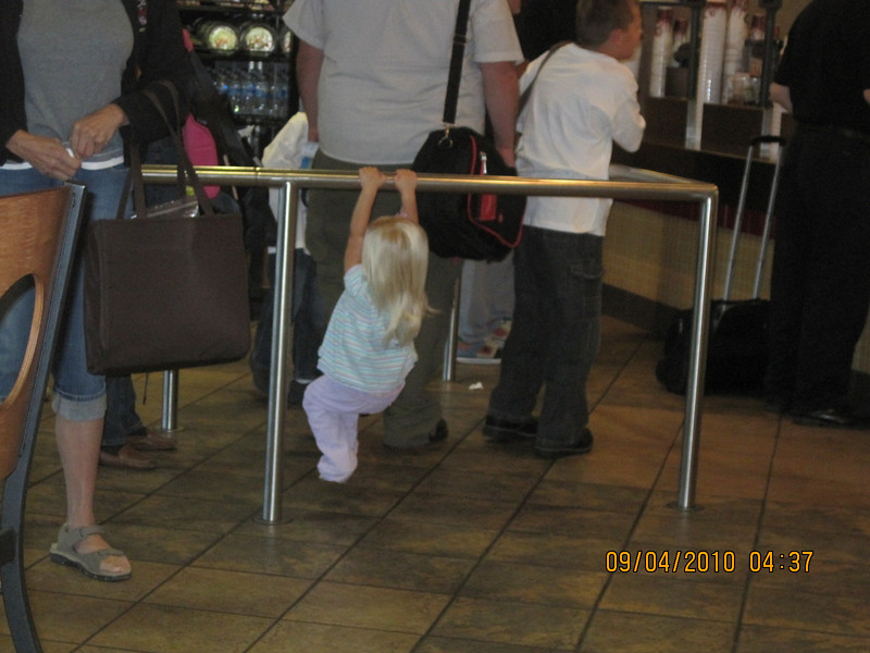 cute little kid swinging at BK waiting line..