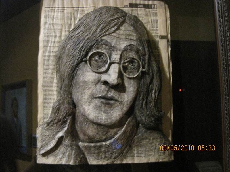 John Lennon carved out of a phone book.