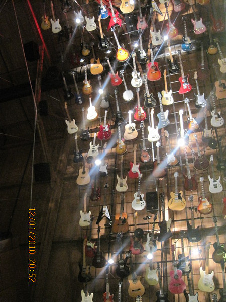 guitars everywhere.. on the wall and on the ceilngs..