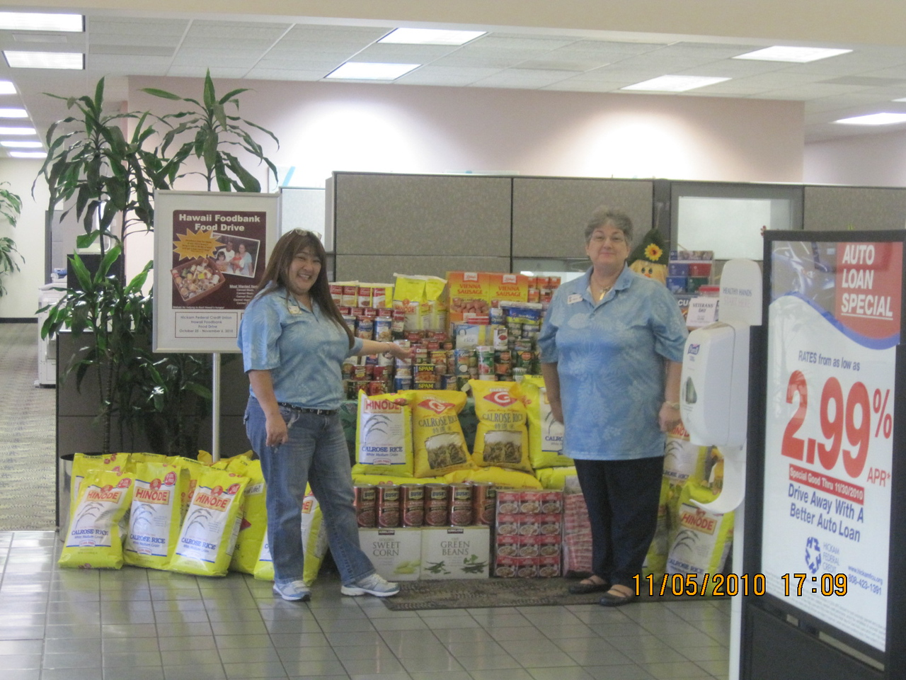 Nyla and Nancy posed here with all the food we got for Hawaii Food Bank.. pau on 5th November.  It was a 2 weeks food drive at all branches.