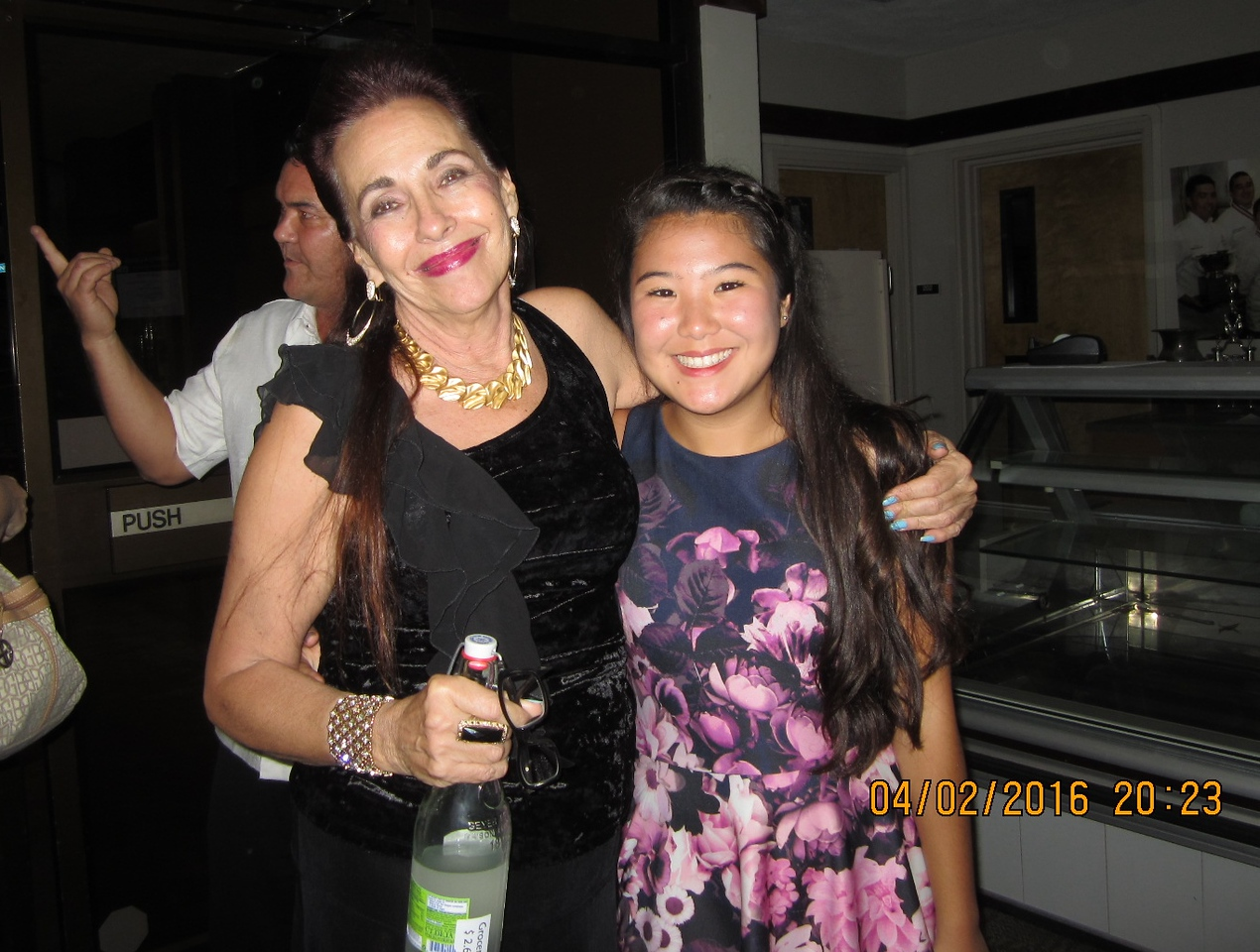 Kathy with the graceful hula dancer.. she learned dance about 11 yrs...