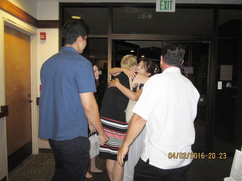 Yuko hugged their guests..