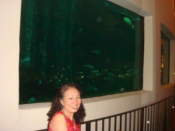 By aquarium of Oceanarium Restaurant..
