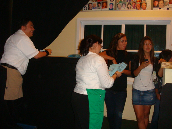 giving out programs to audience