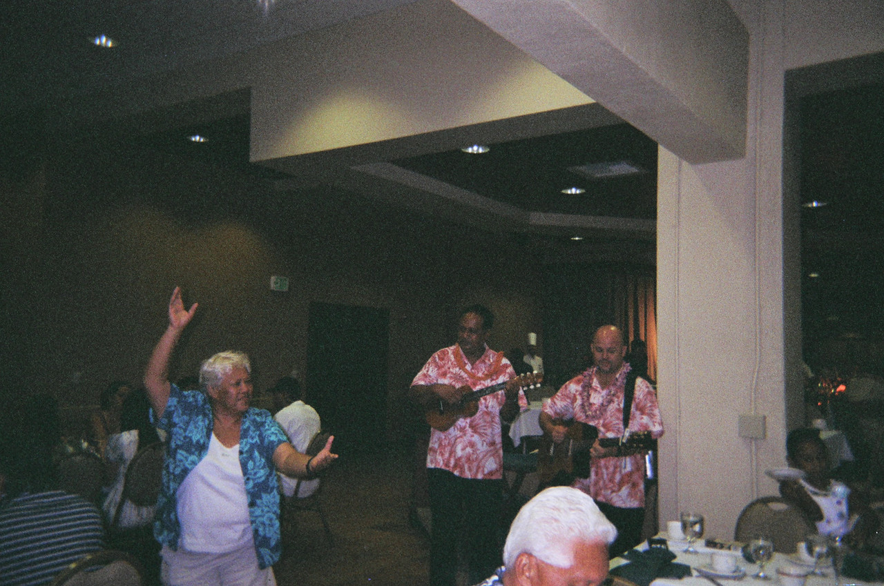 auntie Mui from Maui, performing a hula for her sister's husband Howard 50th birthday.. it's fun!