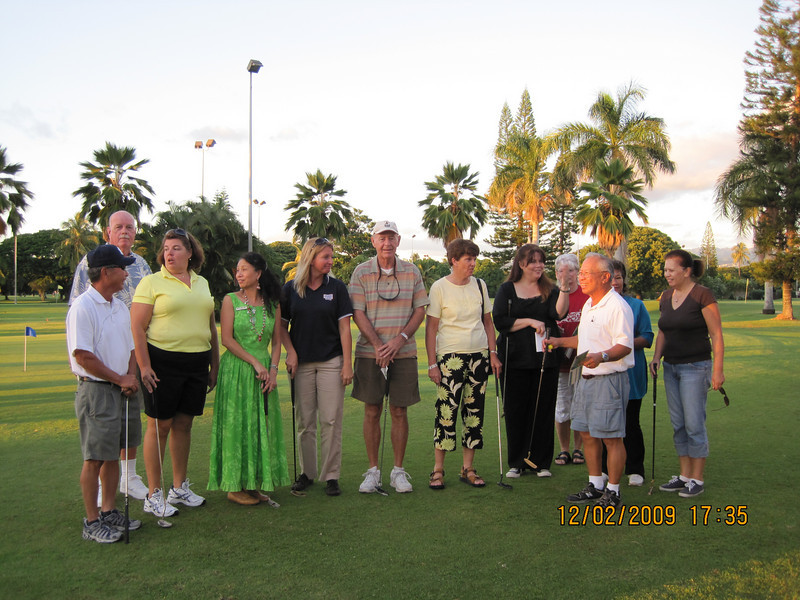 after I left office.. came to Par 3 for this USO gathering event for volunteers.. yeah, I am the only one with muumuu, that was my working clothes..  Ready to putt?   We had 4 teams.  Each team had a semi pro... only Jim and Karl looking at camera.. everyone was busy chatting..