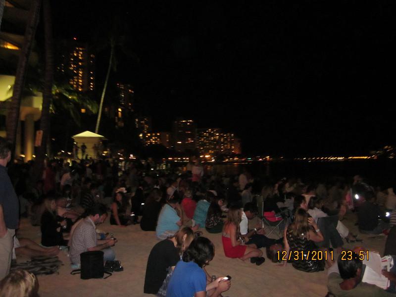 Huge crowds on the Waikiki Beach.. see the time?