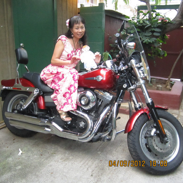 At uncle Ben's apartment complex, the back yard, go for Harley Davidson ride?