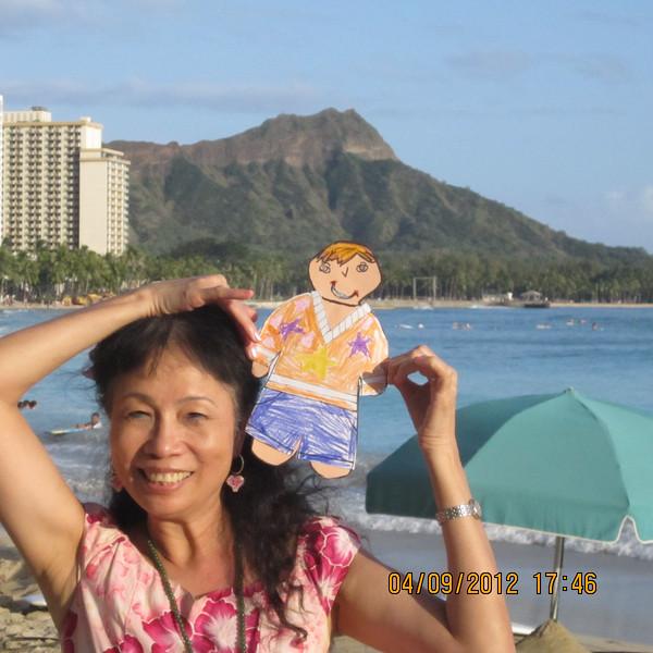 at Waikiki Beach, with Diamond Head Crator in the back ground