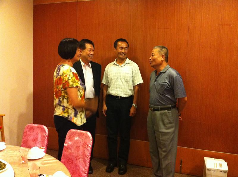 Chi with Principal Tsai, Dr. Lee, and Coach Shay