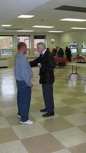 Billy Earle speaking with Ken Ross.