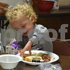 Three-year-old Quinn DiBenedetto of DeKalb eats a peanut butter and jelly sandwich during Summer Lunch and More's meal on June 27. SLAM offers free lunch for the community and those in need from noon to 1 p.m. Tuesdays through Fridays until Aug. 4 at First United Methodist Church, 317 N. Fourth St. in DeKalb.