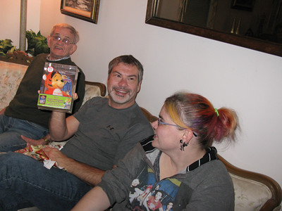 Mark (Froseth) made out as well with a Tiger toy and movie. Opa and Jenna look on with envy.
