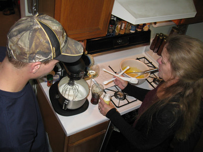 Rose making homemade eggnog with her trusty assistant, Cody (Betty's #4 child).