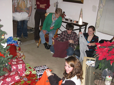 Opening their first gifts, tee shirts sewn into shopping bags. Heehee. Green AND useful.