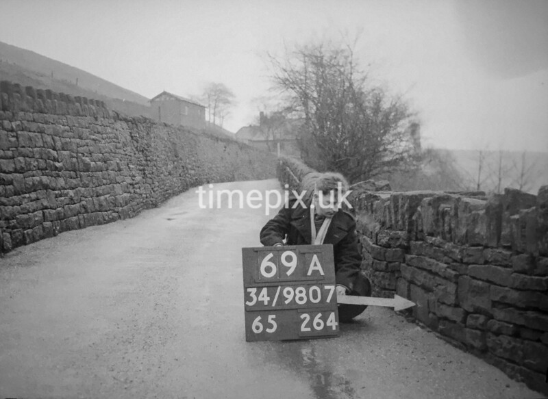 SD980769A2, Man marking Ordnance Survey minor control revision point with an arrow in 1950s