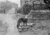 SD990389A, Man marking Ordnance Survey minor control revision point with an arrow in 1950s