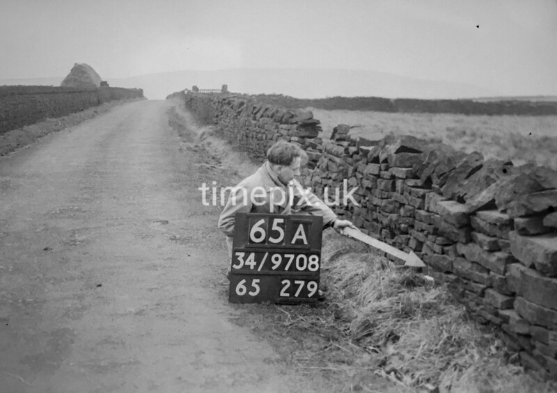 SD970865A2, Man marking Ordnance Survey minor control revision point with an arrow in 1950s
