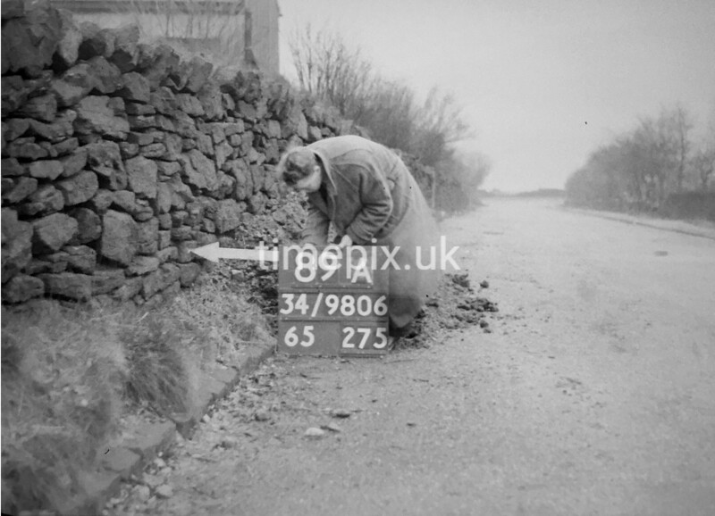 SD980689A, Man marking Ordnance Survey minor control revision point with an arrow in 1950s