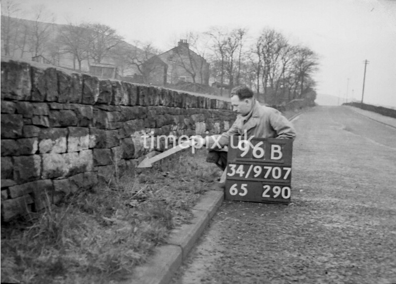 SD970796B, Man marking Ordnance Survey minor control revision point with an arrow in 1950s