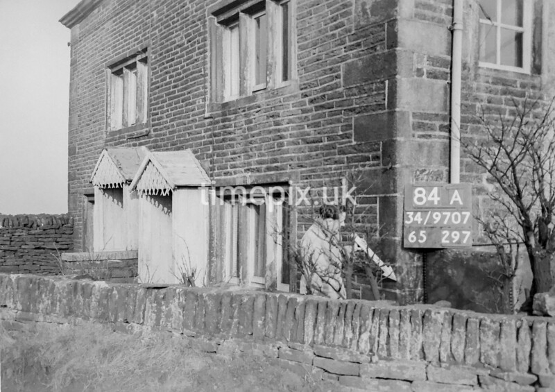SD970784A, Man marking Ordnance Survey minor control revision point with an arrow in 1950s