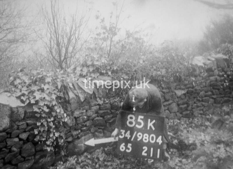 SD980485K, Man marking Ordnance Survey minor control revision point with an arrow in 1950s