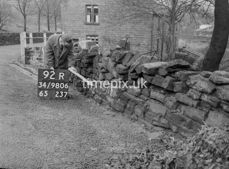 SD980692R, Man marking Ordnance Survey minor control revision point with an arrow in 1950s