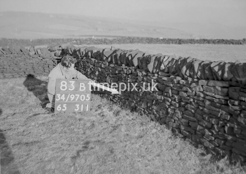 SD970583B2, Man marking Ordnance Survey minor control revision point with an arrow in 1950s