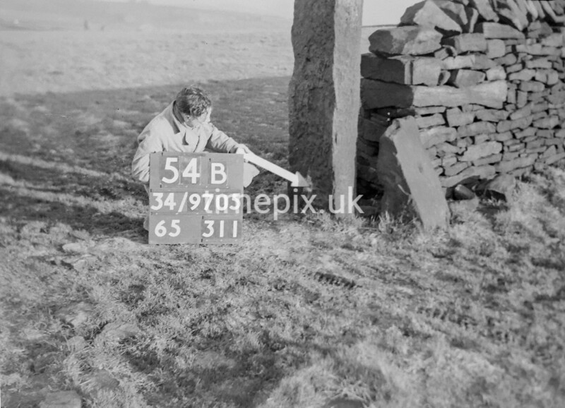 SD970554B2, Man marking Ordnance Survey minor control revision point with an arrow in 1950s