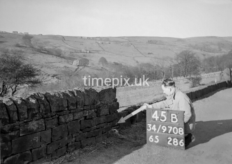 SD970845B, Man marking Ordnance Survey minor control revision point with an arrow in 1950s