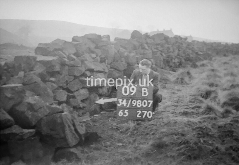 SD980709B, Man marking Ordnance Survey minor control revision point with an arrow in 1950s