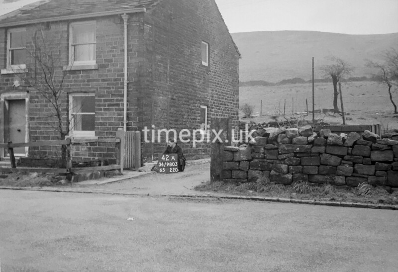 SD980342A, Man marking Ordnance Survey minor control revision point with an arrow in 1950s