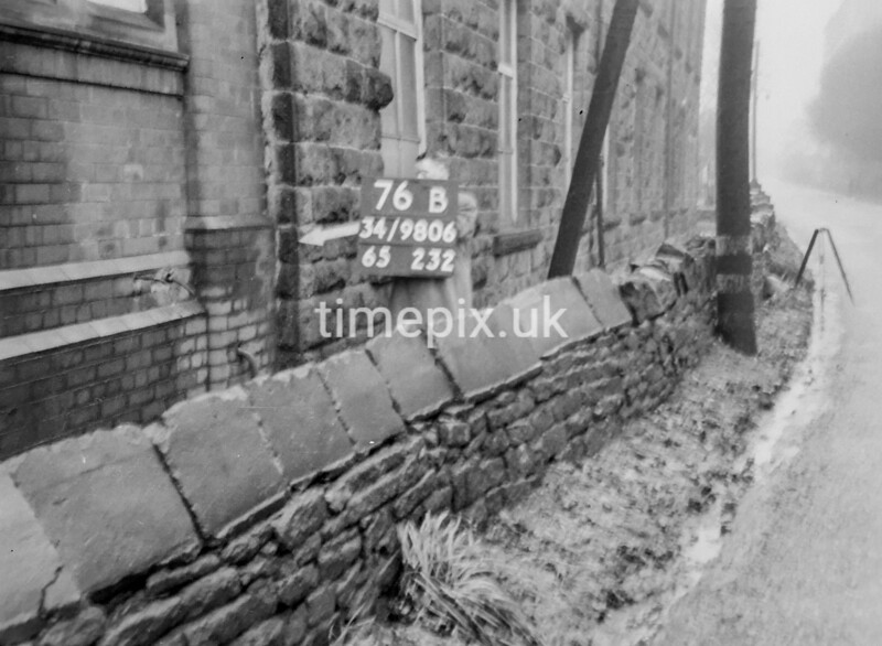 SD980676B, Man marking Ordnance Survey minor control revision point with an arrow in 1950s