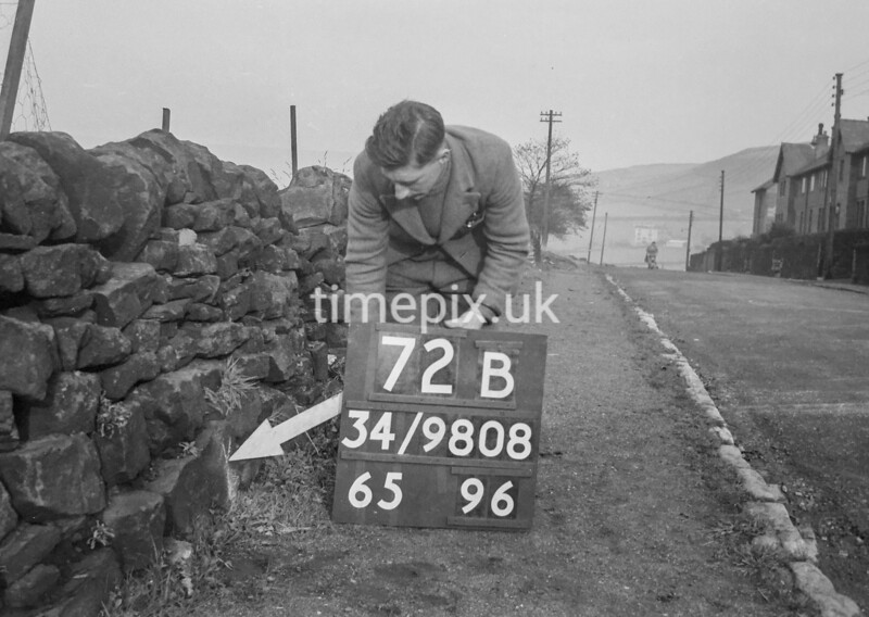 SD980872B, Man marking Ordnance Survey minor control revision point with an arrow in 1950s