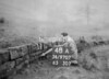 SD970748A, Man marking Ordnance Survey minor control revision point with an arrow in 1950s